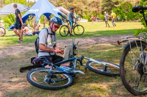 Cyclist getting ready for competition in the forest